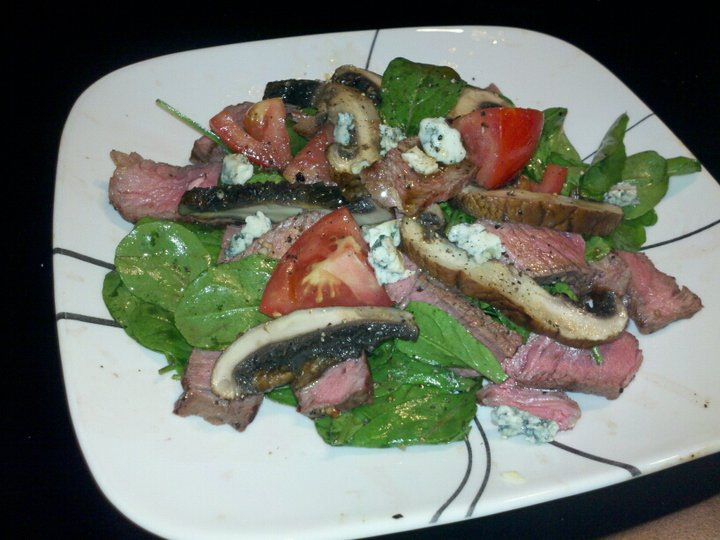 Tomato and Arugula with Grilled Ribeye and Portabella mushroom topped with blue cheese crumb