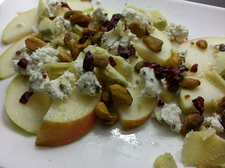 Apple with goat cheese, pistachio, dried cranberries, and sliced ginger.